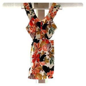 FLORAL ROMPER WITH SIDE CUTOUTS